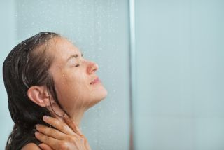A woman with wet hair in the shower