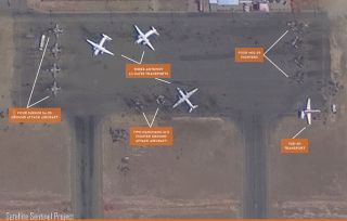 Satellite imagery, such as this photo of a military airbase in Sudan, may help with predicting when atrocities will arise.