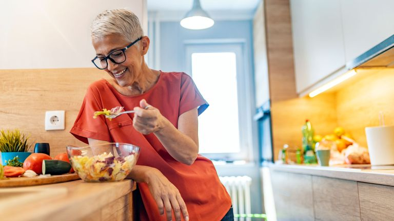Older woman eating the best eye health foods