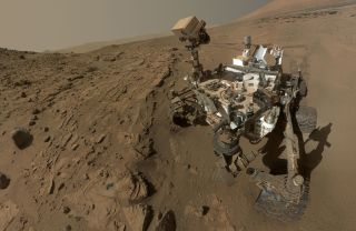 NASA's Mars rover Curiosity, seen here in a self portrait, has made major discoveries on the surface of the Red Planet. The Discovery Channel will chronicle the mission in Red Planet Rover, airing Dec. 18 at 10 pm ET/PT.