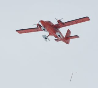 A GPS javelin being dropped by researchers above Antarctica in January, 2013.