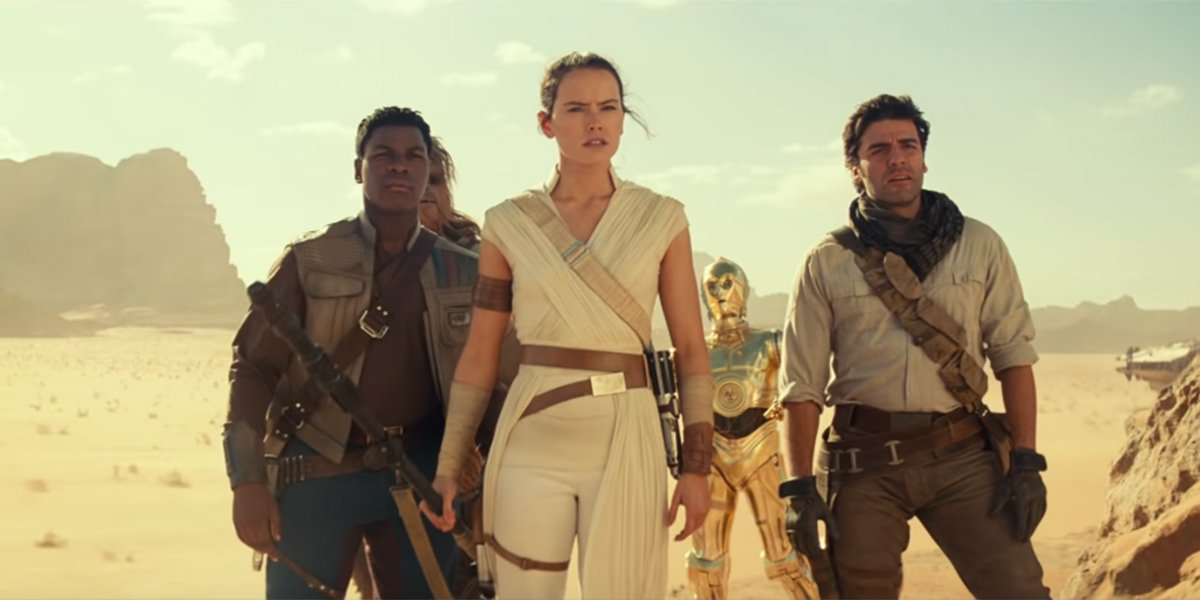 Rey, Finn, Poe, Chewie and C-3PO on a desert planet