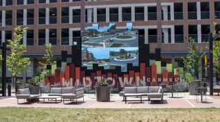 Serving as a piece of art, an avenue for communication, and a source of entertainment, a large Neoti LED video wall sits in the center of the Midtown Plaza.