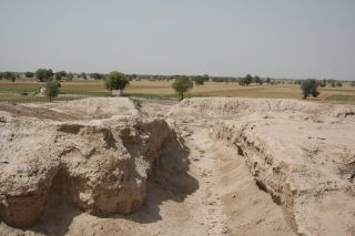 An excavated street at the Indus site of Kalibangan, a Bronze Age settlement that sits right along the Ghaggar-Hakra paleochannel, visible in the background.