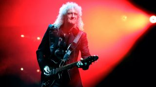 Brian May performs live with Queen + Adam Lambert at The O2 Arena on December 12, 2017 in London