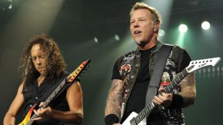 Kirk Hammett and James Hetfield onstage playing guitars