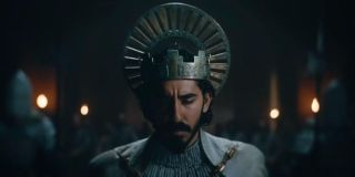 Dev Patel as The Green Knight wearing the king of Camelot crown