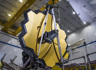 NASA's James Webb Space Telescope has successfully deployed its giant primary mirror, putting the new observatory one big step closer to being ready for launch in 2021. The entire 256-inch (6.5 meters) primary mirror assembly unfurled into the same configuration that it would be after deploying in space. This critical test took place in early March, right before NASA's centers shut down due to the coronavirus pandemic. Work on the Webb telescope was temporarily halted on March 20.
