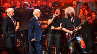 Brian May onstage with Buzz Aldrin