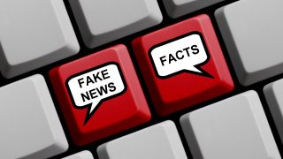 """Red keys on keyboard labeled """"Fake news"""" and """"Facts"""""""