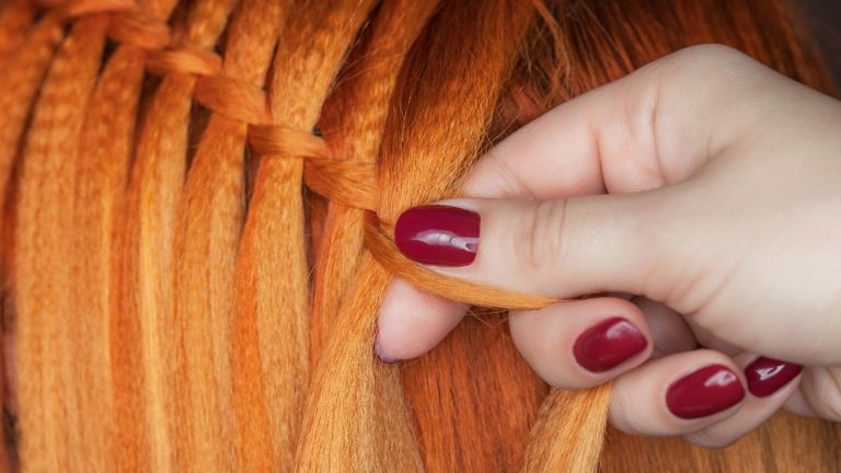 Red hair being braided