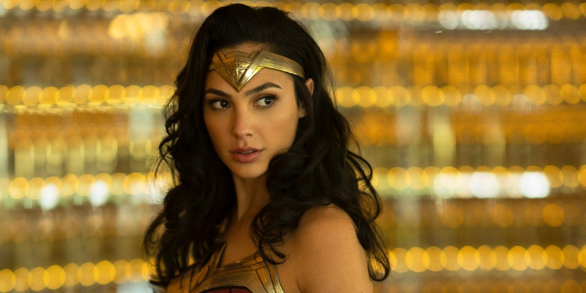 Wonder Woman pausing for a moment as she spots more trouble coming for her in Wonder Woman 1984