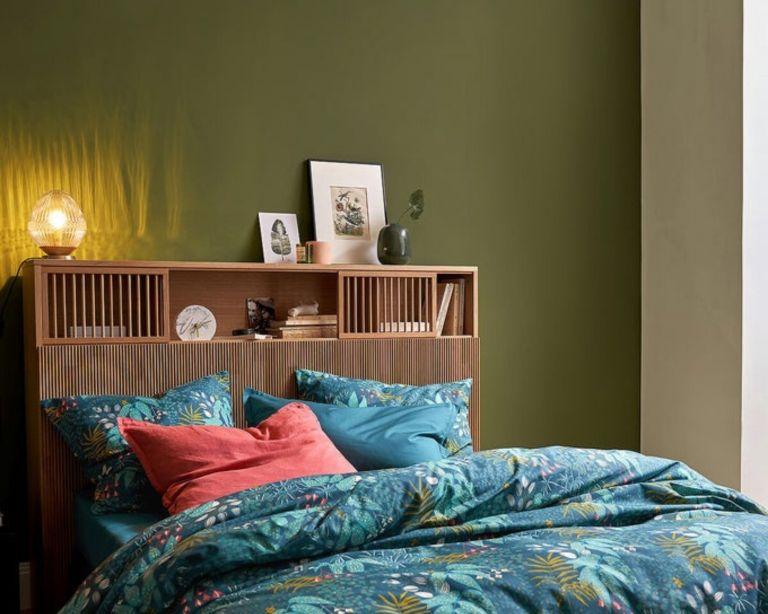 Pilpao Oak Storage Headboard in green bedroom with patterned blue bedding