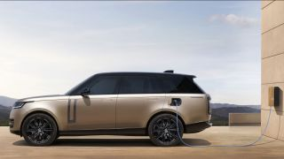 Side profile of the 2022 Range Rover plugged into a charger