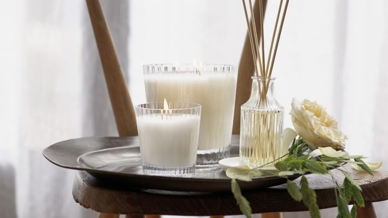 Best candles: The White Company Spring Candle on chair with other scents
