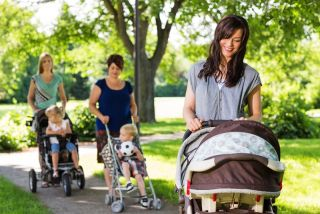 women with strollers in park