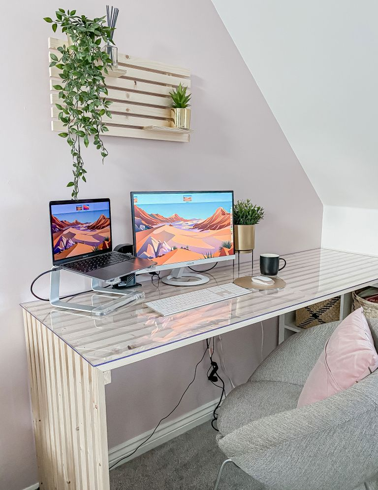 DIY slat desk with laptop, house plants and grey upholstered chair