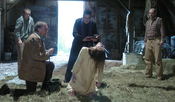 The Exorcism of Emily Rose Tom Wilkinson Jennifer Carpenter mid-exorcism in the barn