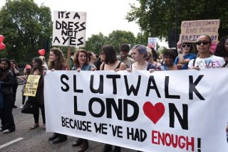 SlutWalk London march with a banner.