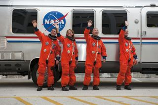 Last shuttle astronauts wave goodbye.