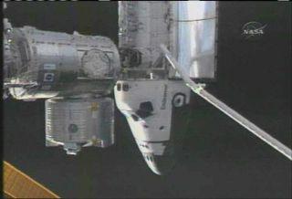 Astronauts Scan Shuttle Heat Shield at Station