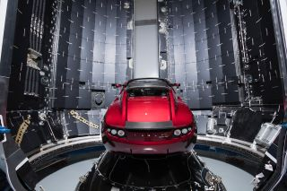 A cherry red Tesla Roadster will serve as the payload on the maiden flight of SpaceX's Falcon Heavy rocket.
