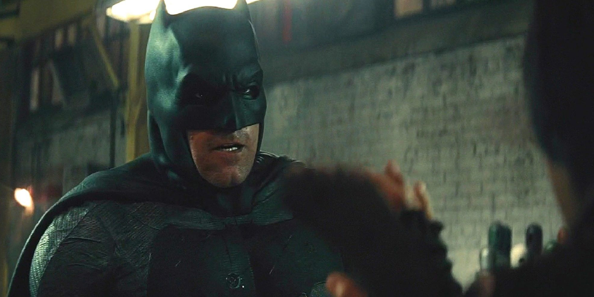 Ben Affleck fights his way through a warehouse in Batman v Superman: Dawn of Justice