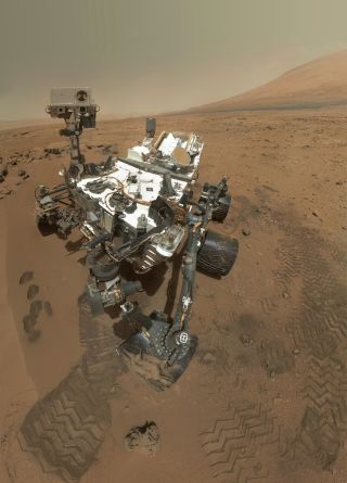 Curiosity is shown at the Martian site of Rocknest.