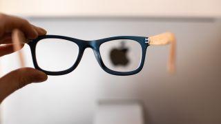 Apple Glass - Apple logo seen through a pair of glasses