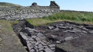 Archaeologists found remains of the drinking hall under what is now a farmstead in Orkney, Scotland.
