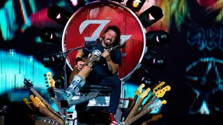 A picture of Dave Grohl performing from his throne in 2015