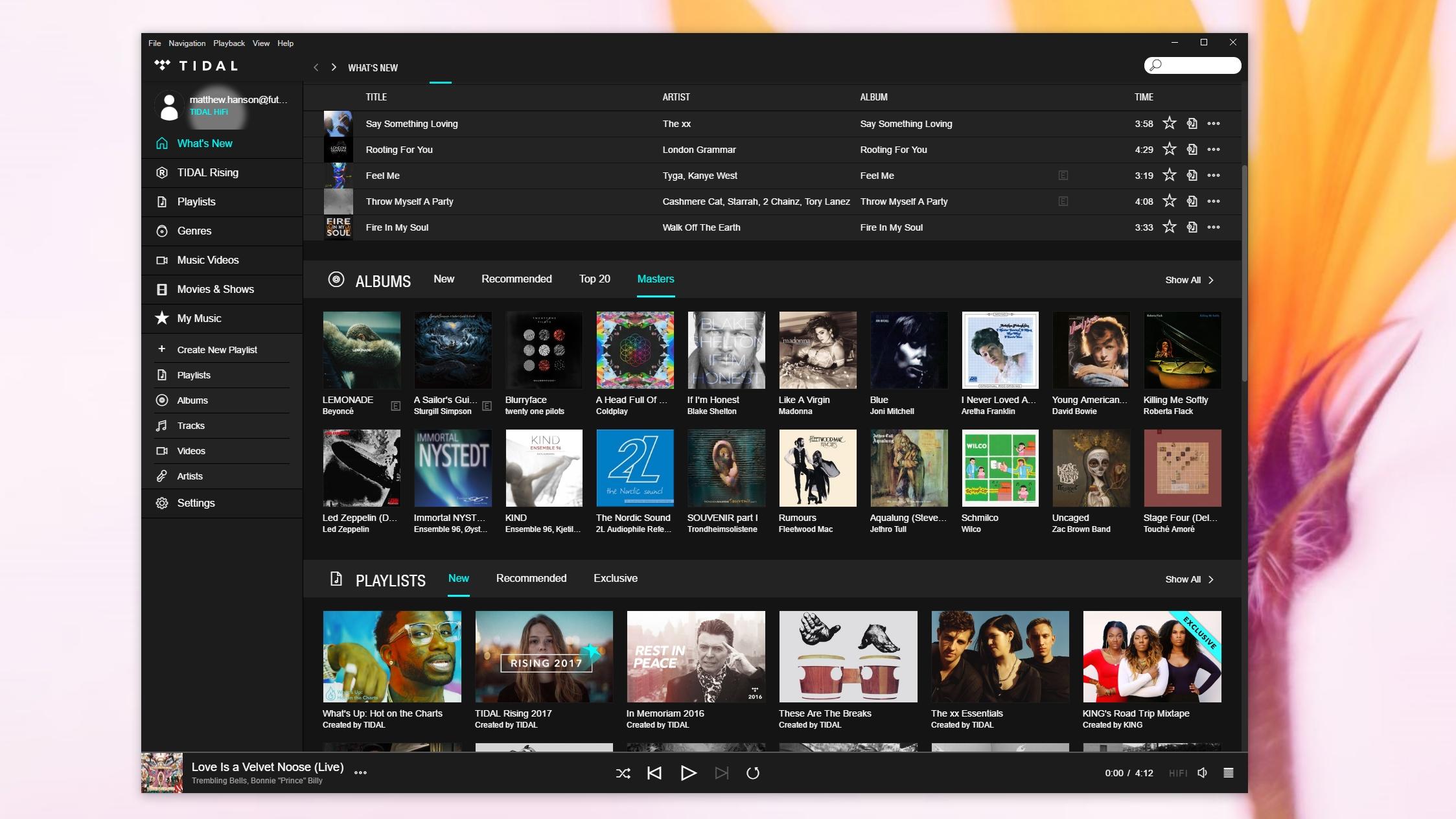 Tidal (yuxarıda) Spotify üçün oxşar Çini əsaslı bir interfeys istifadə edir.