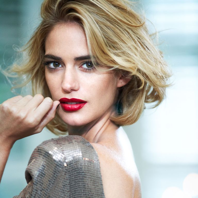 Photo: Model with red lipstick and blonde hair