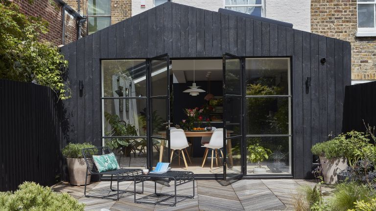 Exterior of a modern kitchen extension with charred timber cladding