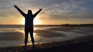 sunset and Laura Kennington on a beach