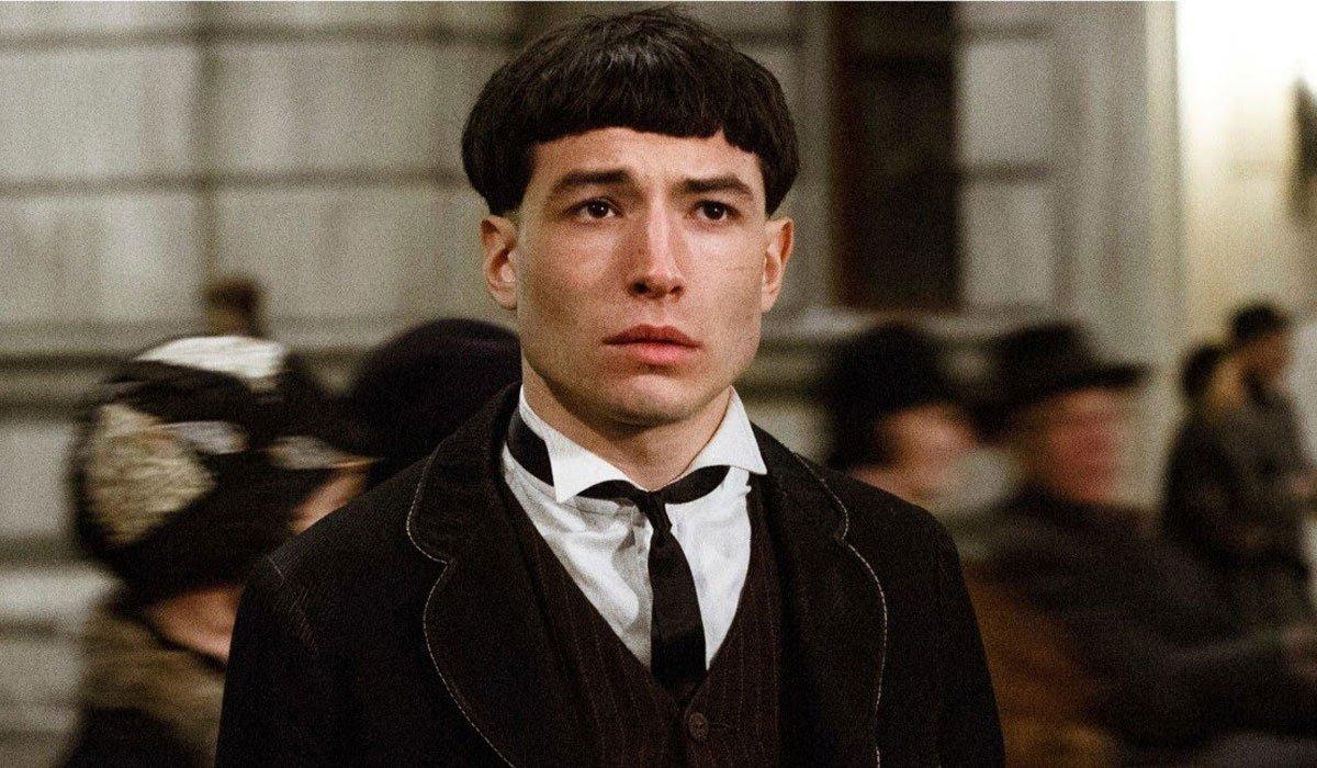 Ezra Miller looking worried with his bowl cut in Fantastic Beasts.