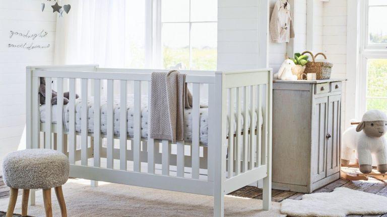 Nursery ideasWhite nursery with wooden cot