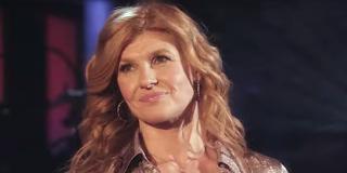Connie Britton smiles on stage in Nashville