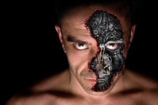 A part-human, part-robot man, in image showing his face.