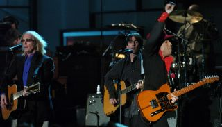 (From left) Tom Petty, Dhani Harrison, and Prince