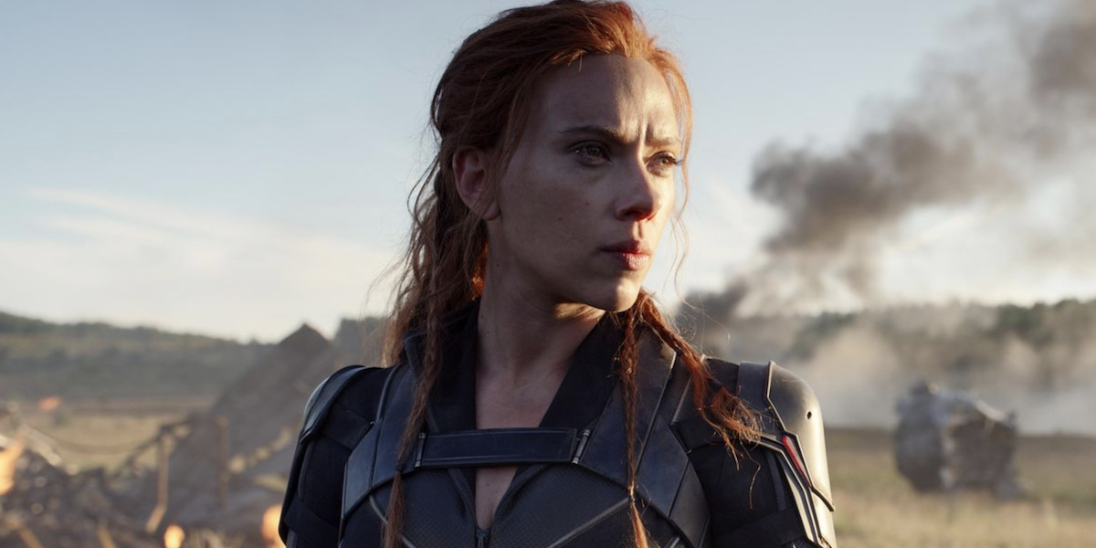 Natasha Romanoff stands in front of smoking debris in 'Black Widow'