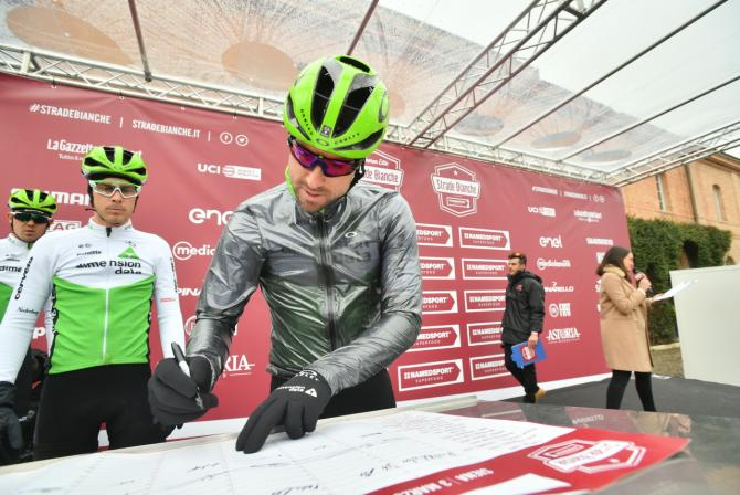Bernhard Eisel was wrapped up in a silver cape at the start
