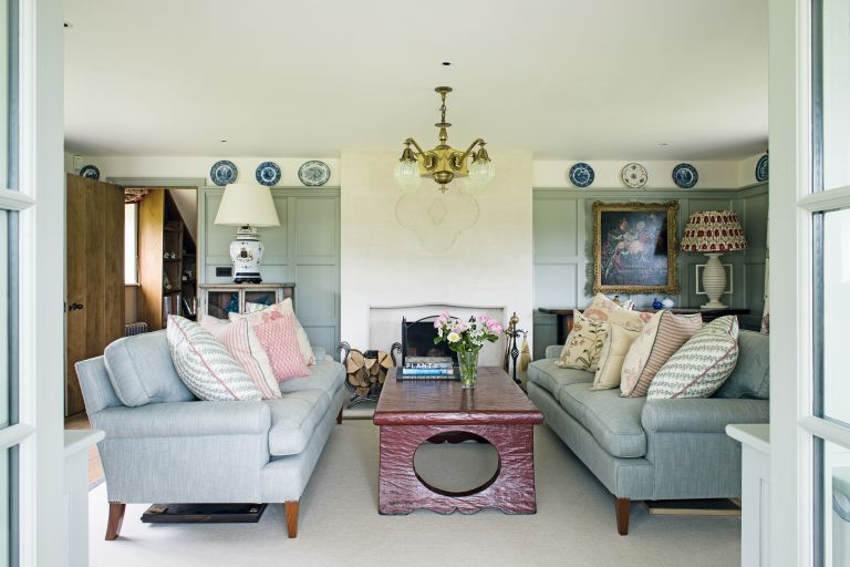 panelled_living_room_with_two_sofas_blue_teal