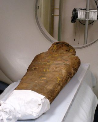 Child mummy goes into the CT scanner at a hospital.
