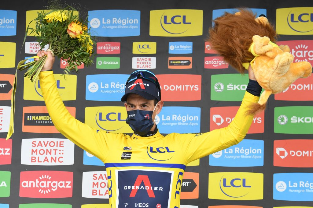 Team Ineos Richie Porte of Australia celebrates his overall leaders yellow jersey on the podium at the end of the seventh stage of the 73rd edition of the Criterium du Dauphine cycling race a 171km between SaintMartinLeVinoux and La Plagne on June 5 2021 Photo by Alain JOCARD AFP Photo by ALAIN JOCARDAFP via Getty Images