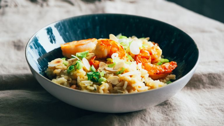Paella served with rice, cooked healthily