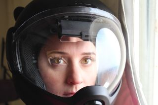 Space.com's Chelsea Gohd wears a helmet inside the HI-SEAS habitat during a two-week analog Mars mission.