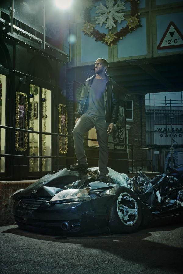 Vincent Hubbard (Richard Blackwood) stands on a crushed car (BBC)