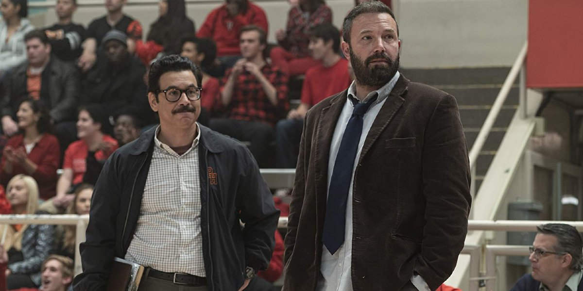 The Way Back Al Madrigal and Ben Affleck watch the players on the court