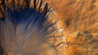 A Fresh Crater near Sirenum Fossae on Mars